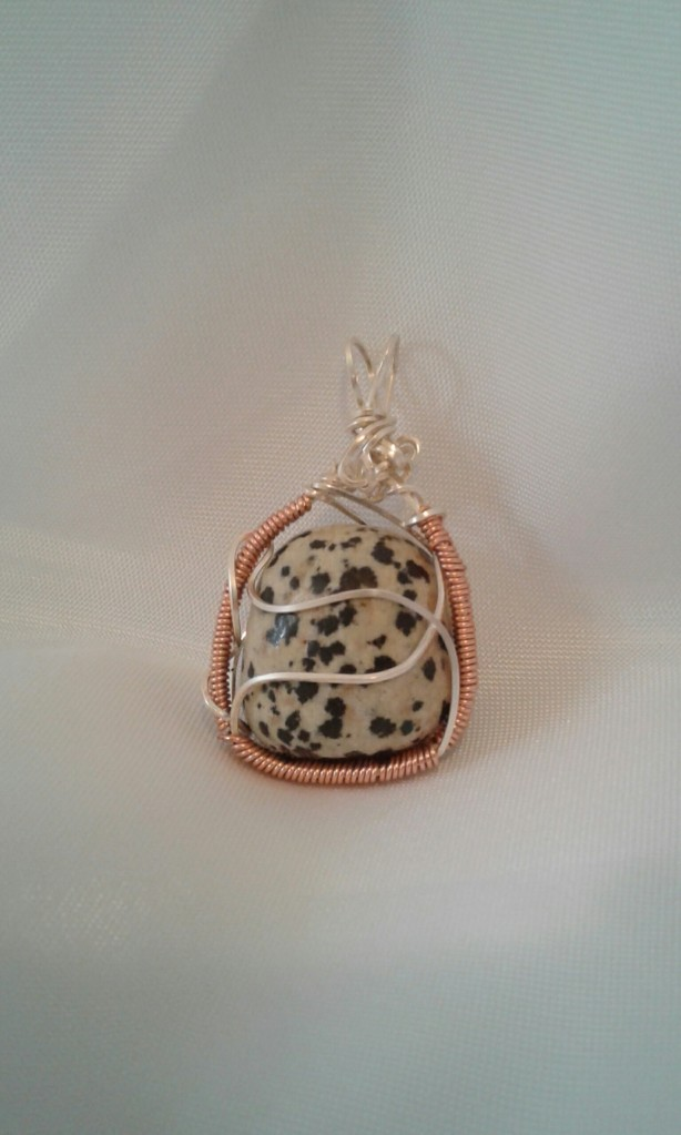 Front view of the Firedog Pendant.