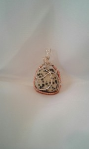 Back view of the Firedog Pendant.