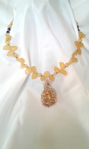 The Number 19 necklace shown modeled.