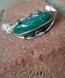 Backside view of Green Cheese pendant to show cab thickness