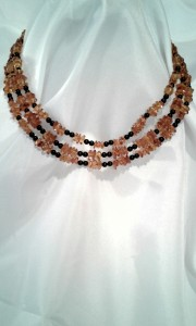 The Queen Bee necklace as worn on model.