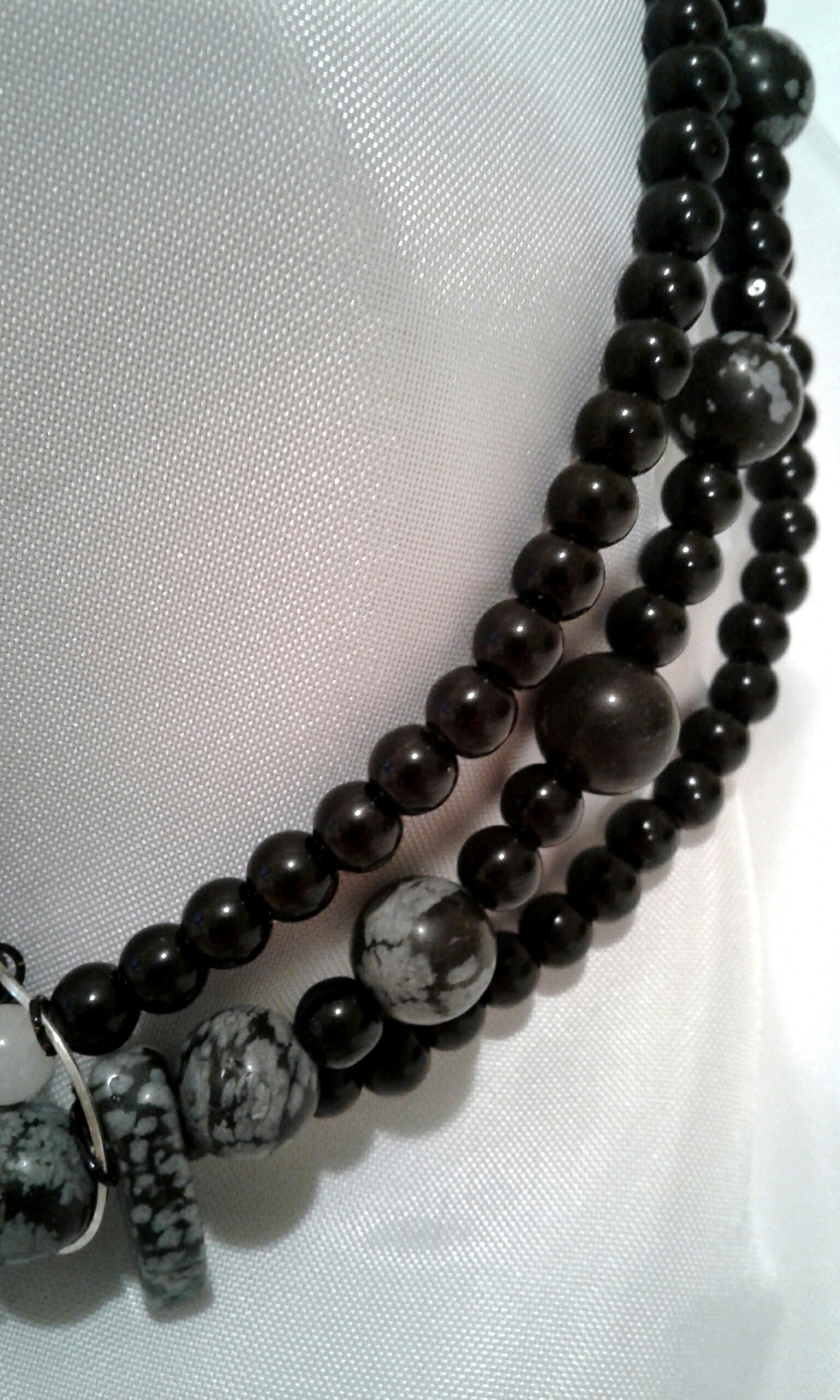 Close-up shot of obsidian beads.