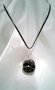 Shot of the Snowflake Pendant as worn by a model.