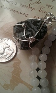 Snowflake Pendant size compared with a quarter