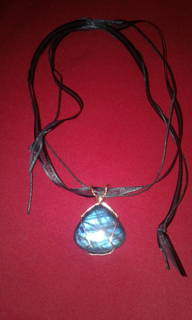 Labradorite pendant on ribbon necklace, shot using camera flash