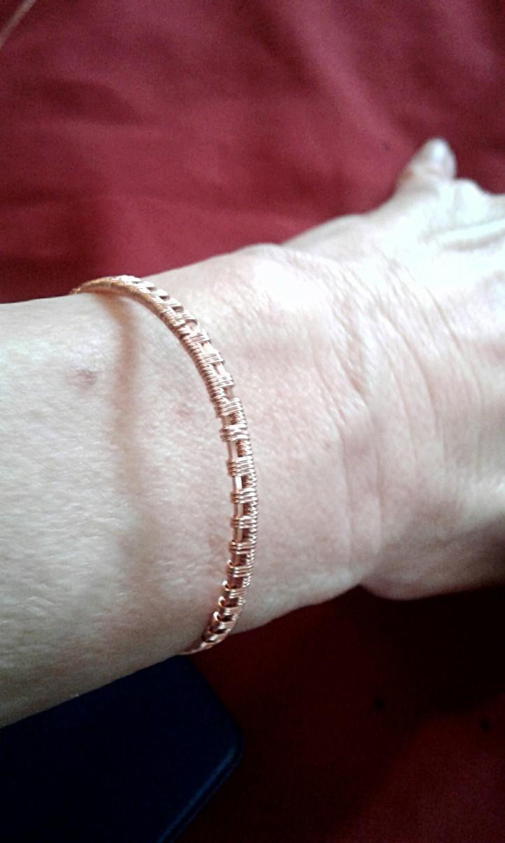 Wire weave cuff bracelet modeled by the artist