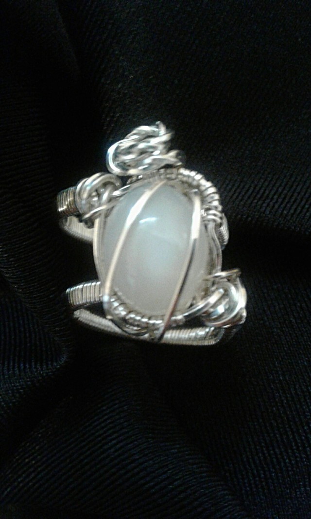 Moonstone Ring wrapped and woven with silver-filled wire.