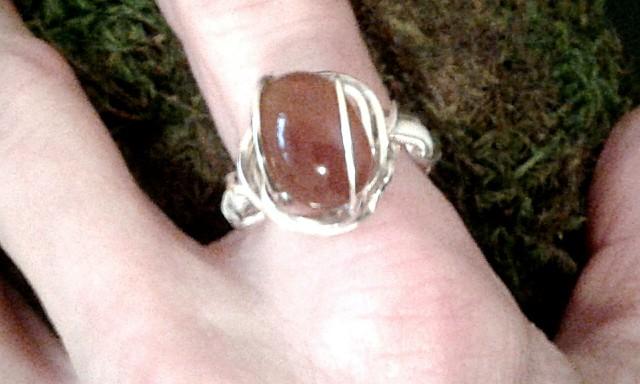 Helia's Tear ring modeled on hand