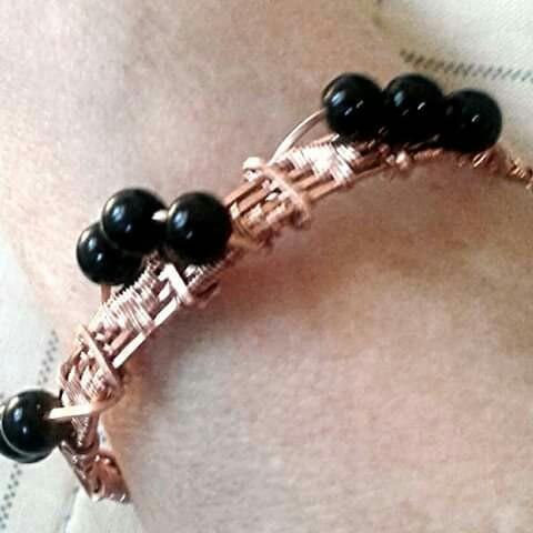 Model wearing wire woven bracelet.