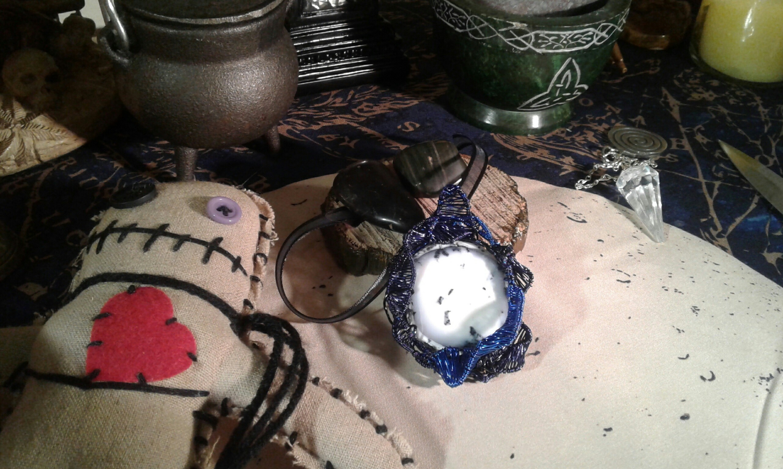 Mirror Mirror pendant pictured on my Altar with a poppet